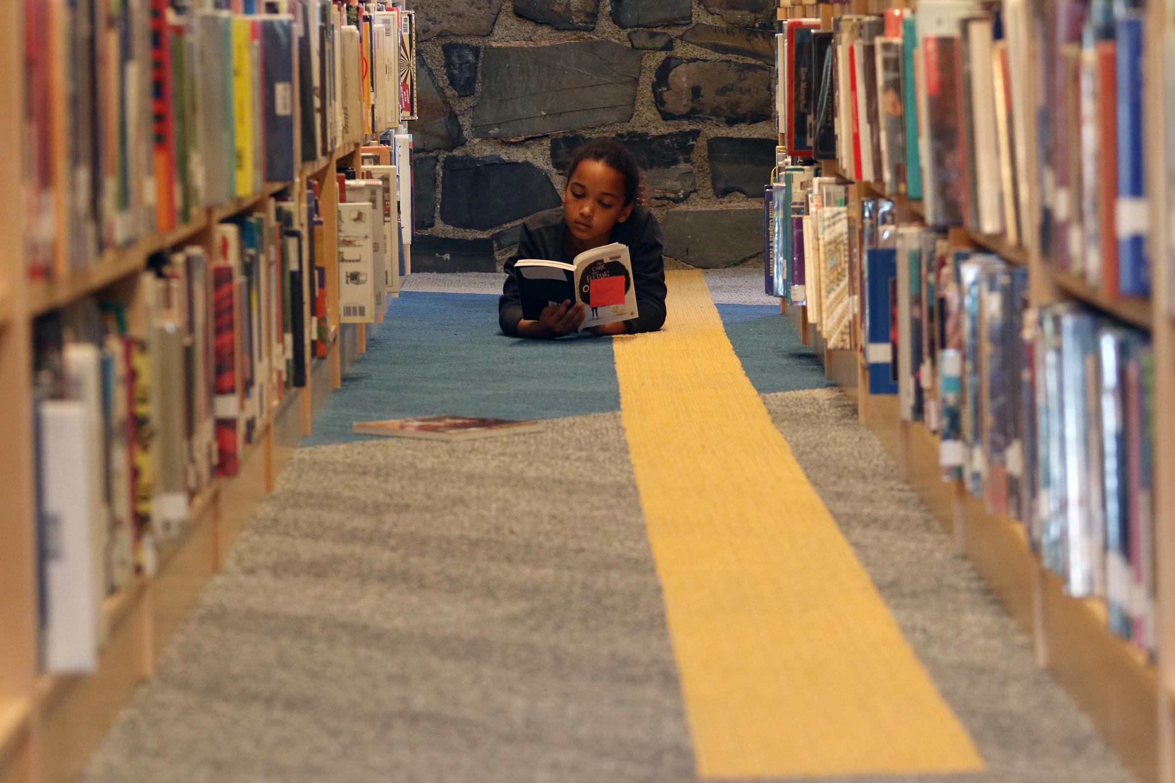 A student reads in the Erskine Library
