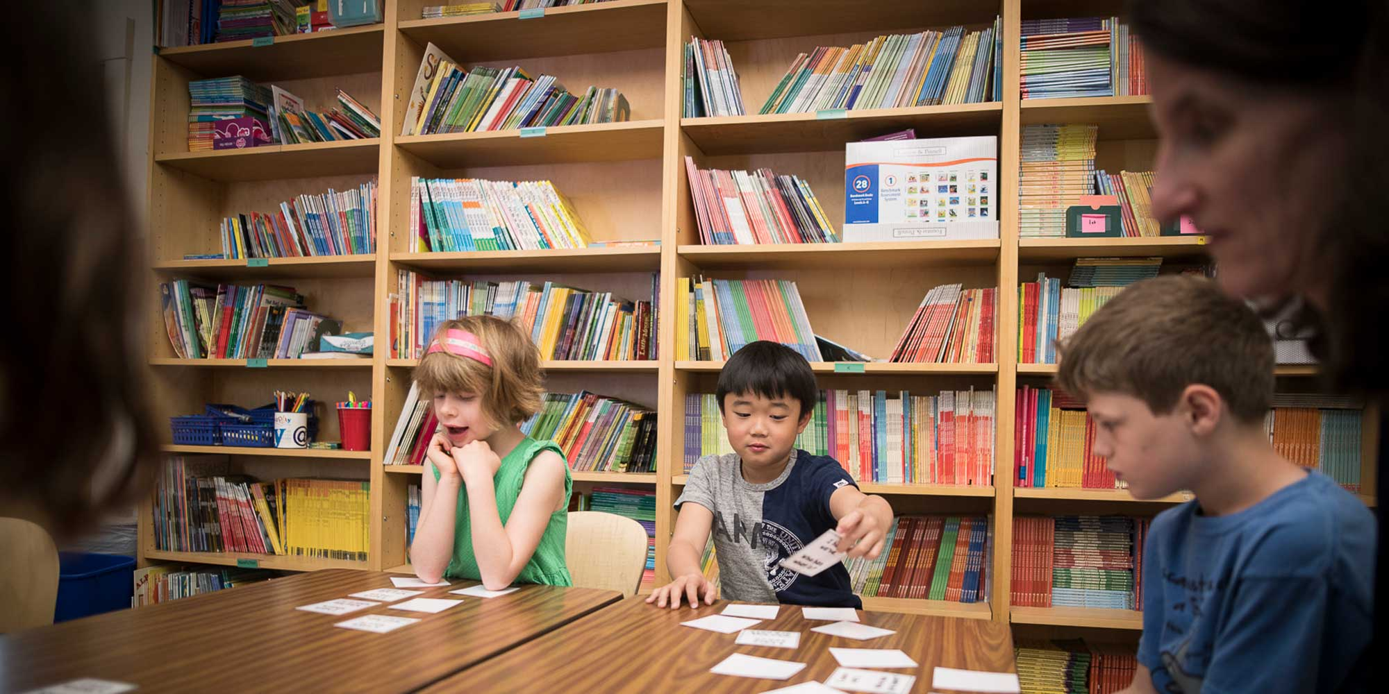 Lower school students in the reading room