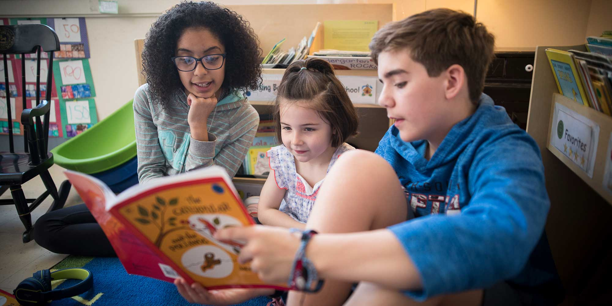 Three cross-graded partners read together | Belmont Day School