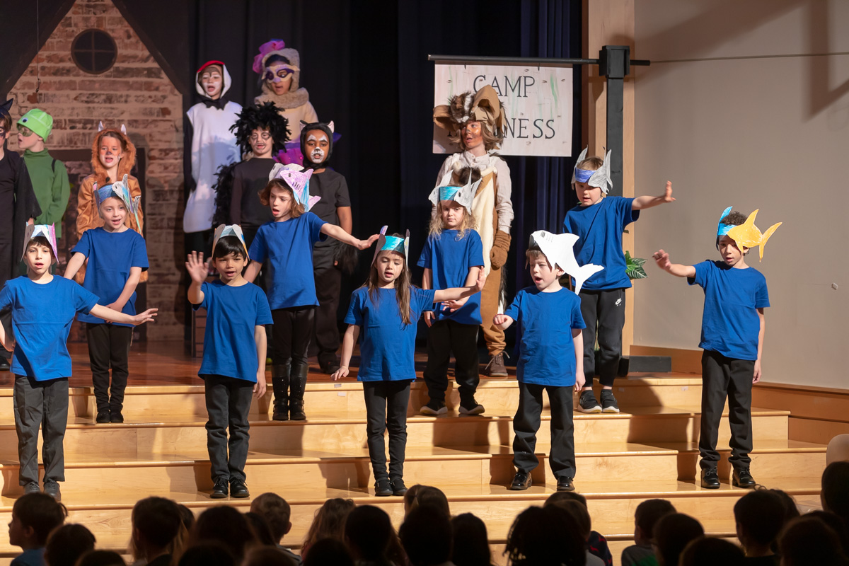 The cast of the class play on stage