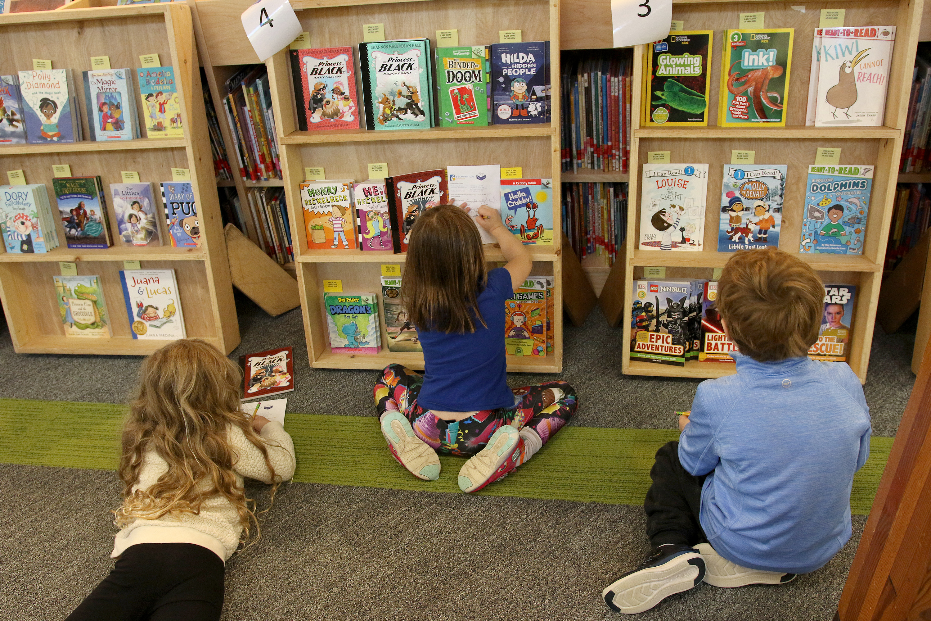 Students browse books at the book fair