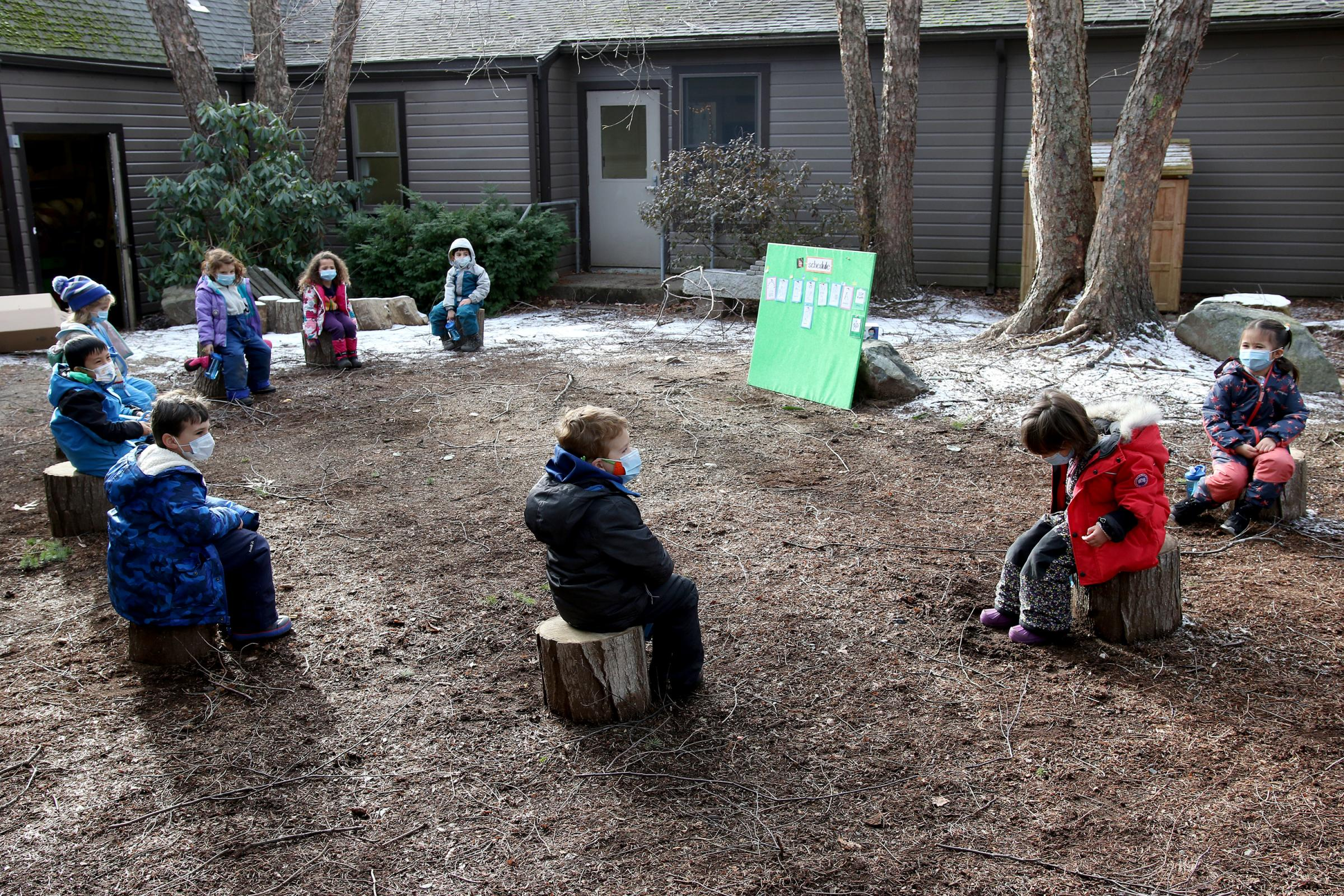 Pre-k students in a circle in the Courtyard