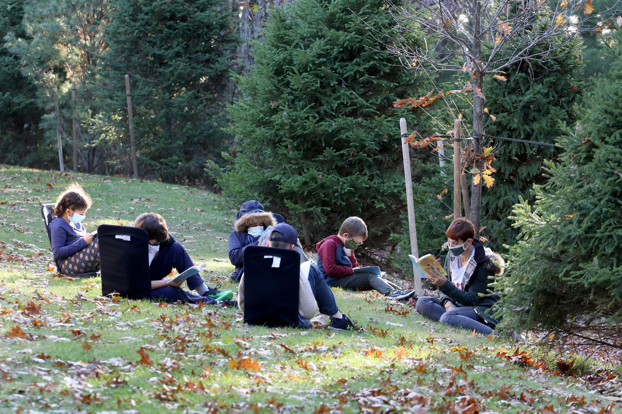 A reading group outdoors