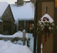 The snowy stone cottage at Belmont Day