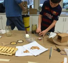 A student works on building a new hive component
