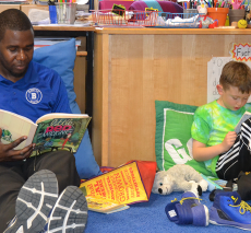 Students and teachers read together for Gaining Ground