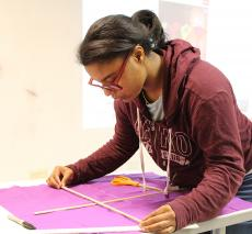A student builds a kite for Mary Poppins Jr.