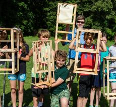 Students display their wood towers.
