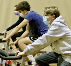 Eighth Graders On Exercise Bikes