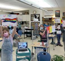 Third Graders Holding Signs