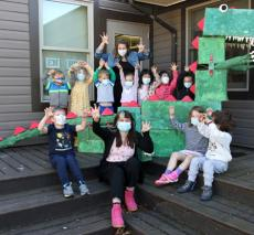 Pre-kindergartners With Dinosaur Sculpture