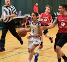 Sami Awad takes the ball down the court against Cambridge Friends.