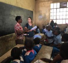 Debbie Grossman doing a letter exchange with Kenyan teacher.