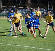 Girls' lacrosse team competes against Shady Hill School.