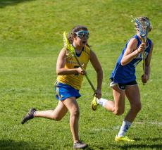 Girls' lacrosse team competes against Carroll School.