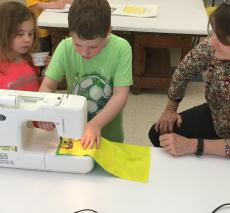 first graders work on their pillow projects.