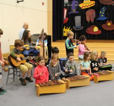 """Second grade rehearses the overture for their upcoming production of """"Hats!"""""""