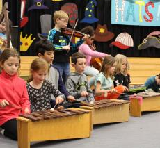 "Second grade rehearses the overture for their upcoming production of ""Hats!"""