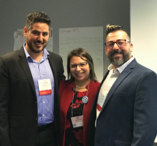 William Yepes-Amaya with two colleagues presenting at a conference