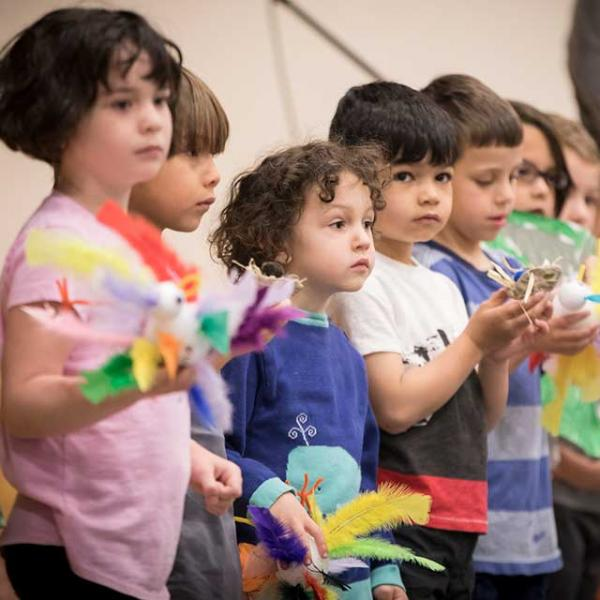 Pre-k shares what they learned about birds at sharing assembly