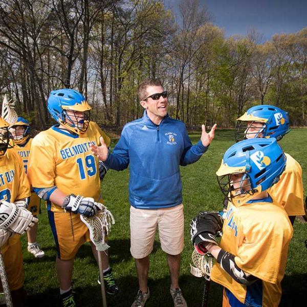 Lacrosse players and coach