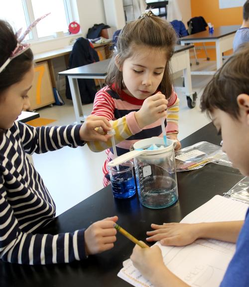 First graders conduct an experiment about clouds