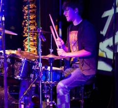 Alumnus Ben Clossey performs at Battle of the Bands