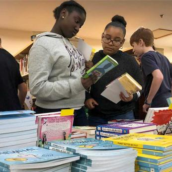 Students browse book selections
