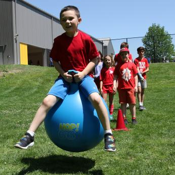 A student on a hippity hop during field day