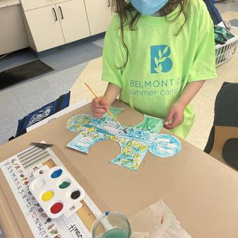 First Grader Painting Mural