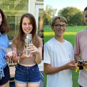 Students Holding Their Winning Technology Projects