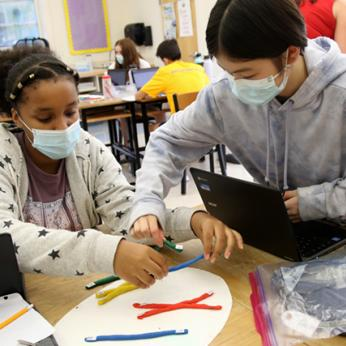 Middle School Students Working In Science Class